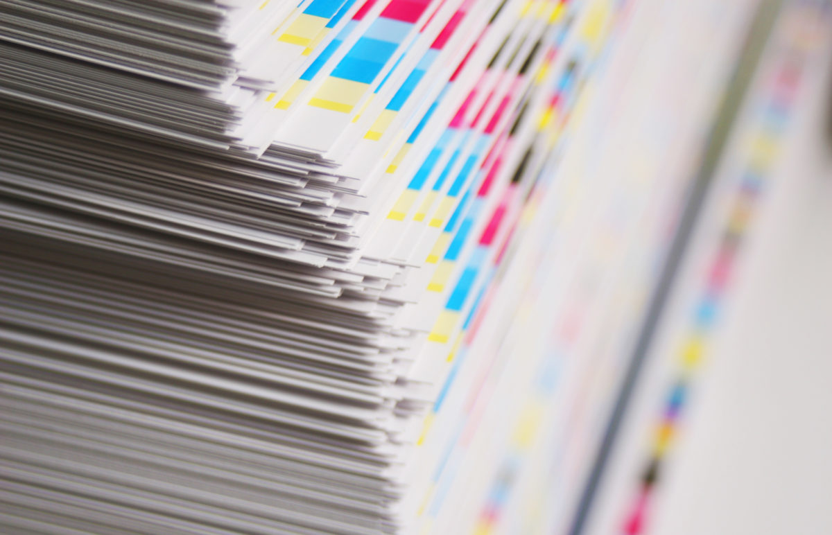 CMYK color bars on printed sheets of paper
