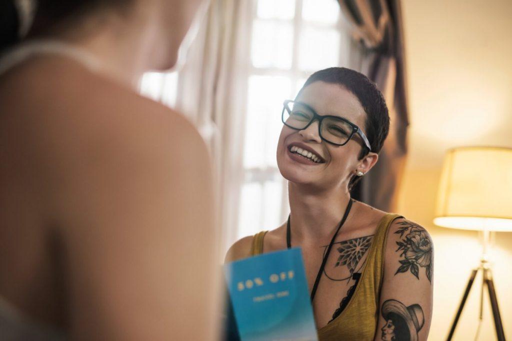 beautiful shirt hair white tattooed woman holding blue leaflet