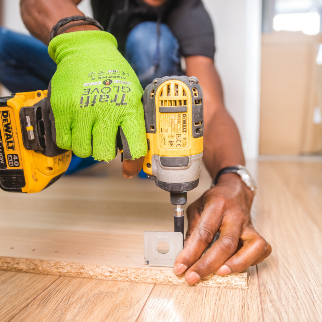 multi cultural hands working with dewalt drill on carpentry skills