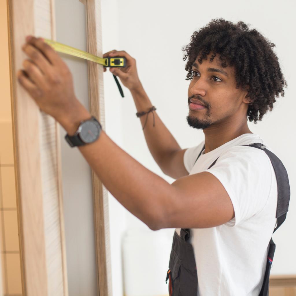 handyman with tape measure