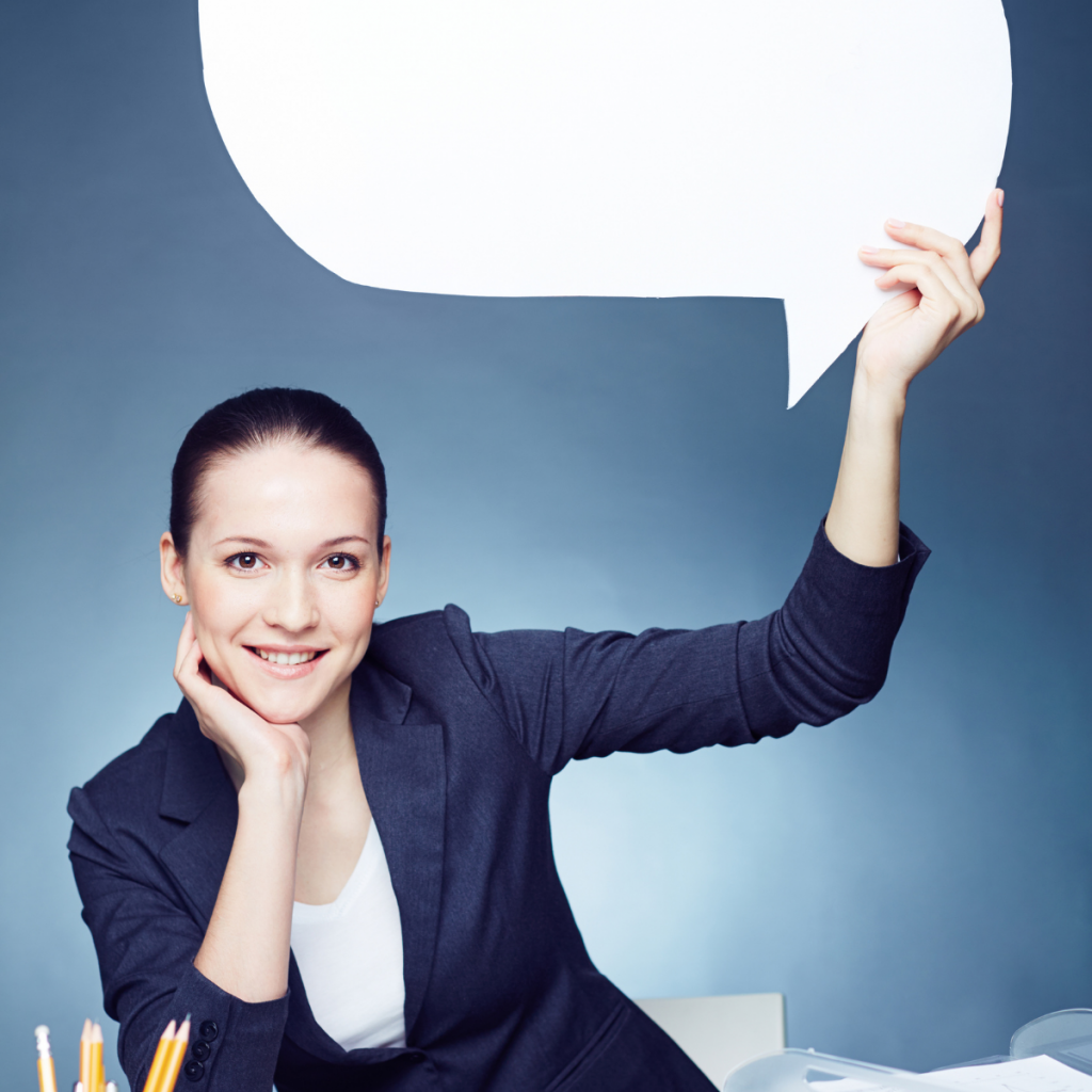 woman holding up a speech bubble which is blank